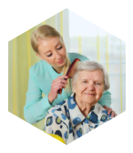 caregiver combing hair of the old woman
