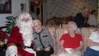 a portrait of santa claus and group of elderly people